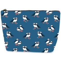 A charming fabric cosmetic bag in a navy tone covered with a cute Puffin decal
