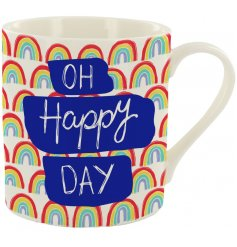 A fine china mug featuring printed rainbows and positive scripted text