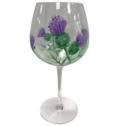 A tall stemmed Wine Glass featuring a beautifully hand painted Purple Thistle design