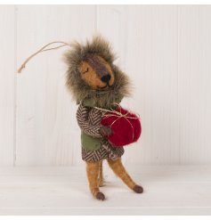 An adorable woollen lion decoration dressed up and holding a red present