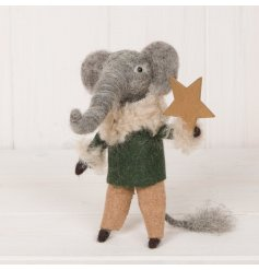 A sweet and small standing woollen elephant dressed up with fluffy trimmings