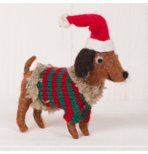 A festive little woollen doggy decoration dressed up in his favourite knitted jumper