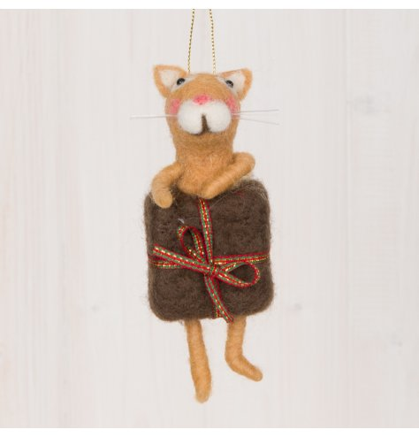 A festive little woollen ginger cat decoration popping out of a present