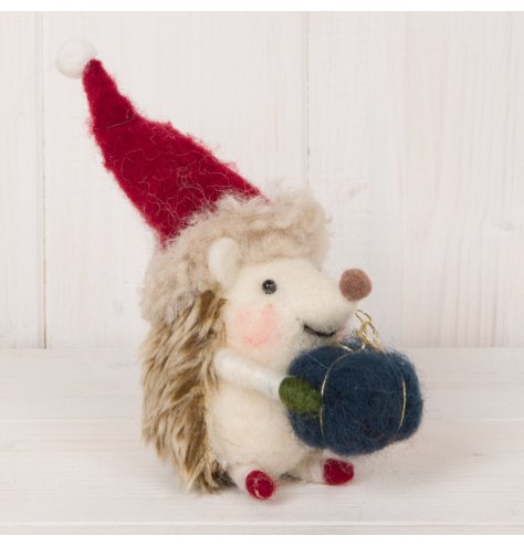 A small woolly hedgehog dressed with a festive hat and blue parcel