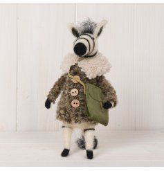 An adorable woollen zebra decoration complete with a fuzzy coat and green satchel