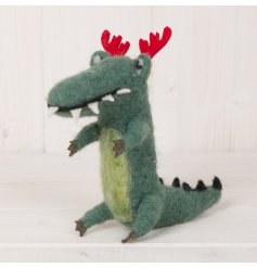 An adorable woollen crocodile decoration complete with a pair of festive antlers
