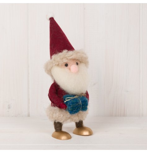 A festive little woollen santa decoration set with fuzzy trimmings and gold wooden feet
