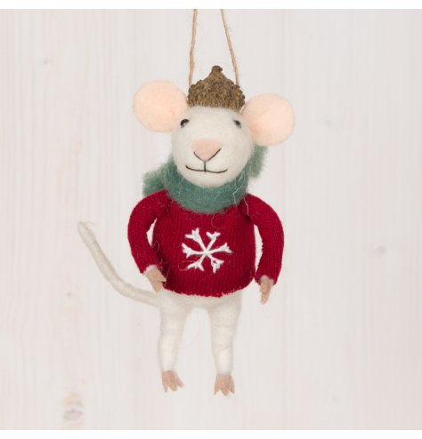 A festive little woollen mouse dressed up in a knitted jumper, scarf and acorn hat