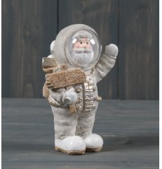 A standing resin santa dressed up in an Astronaut suit
