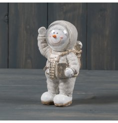 A cute and quirky polyresin Snowman dressed up as an Astronaut