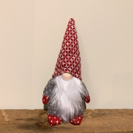 An assortment of Nordic coloured Fabric Gonk Decorations, each set with a traditional fuzzy white beard