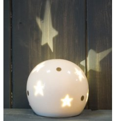 A small and simple rounded ceramic ball set with star cut details and added gold dots