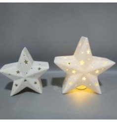 A small ceramic star decoration with cut decals and a warm glowing LED centre