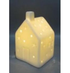 A chic and simple little ceramic house decoration fitted with an illuminating led centre