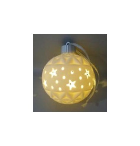 A simplistic Ceramic Bauble with a warm glowing LED centre display and star cut pattern