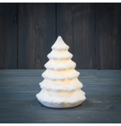A white ceramic Tree Ornament with an added warm glowing LED centre