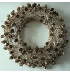A large round rustic woodland inspired wreath with entwined twigs and mini pinecones