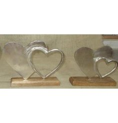 A simple and rustic inspired wooden decoration with an added aluminium double heart display on it