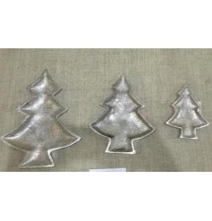 A small decorative metal plate in a shape of a tree