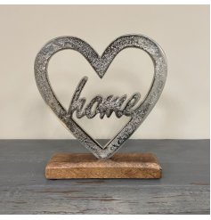 A sleek aluminimum heart ornament with a scripted 'Home' centre