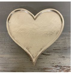 A simple yet chic decorative heart plate with a tarnished silver setting