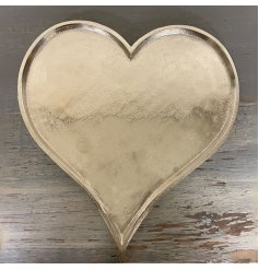 Perfect for placing in any home space, a sleek and simple metal heart plate in a silver tone