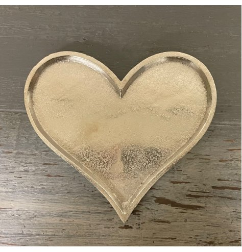 A simple heart shaped decorative plate with a distressed charm and silvered tone