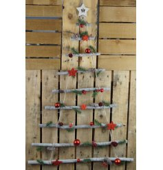 A hanging tiered decoration set with real branches, pinecones, foliage, berries and more!
