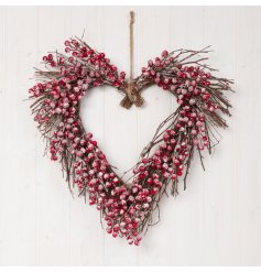 Covered with glitter frosted berries, this charmingly festive themed wreath will hang perfectly on any front door at Ch