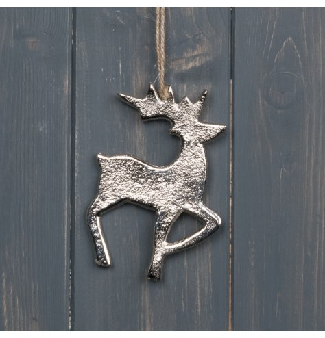 A hammered metal reindeer decoration with a sleek silver tone and jute string hanger