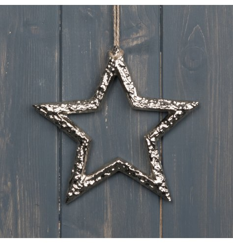 A hammered metal star with a sleek silver tone and jute string hanger
