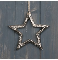 A hanging metal star decoration set with a rough silver coating