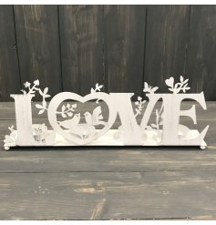 A vintage inspired metal tlight holder set with a charming bird cut decal and bold LOVE text