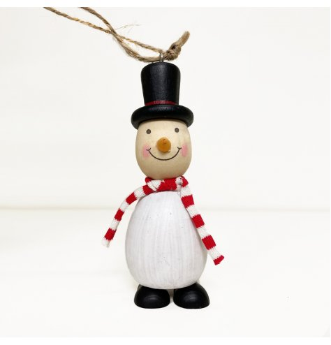 A small hanging decorative snowman covered with traditional festive tones