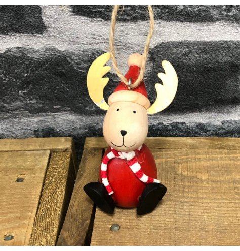 A small hanging decorative reindeer covered with traditional festive tones