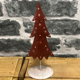 A metal standing tree decoration set with festive and traditional tones
