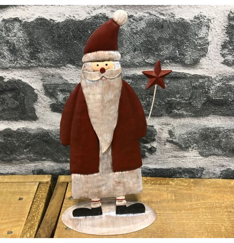 A metal standing santa decoration set with festive and traditional tones