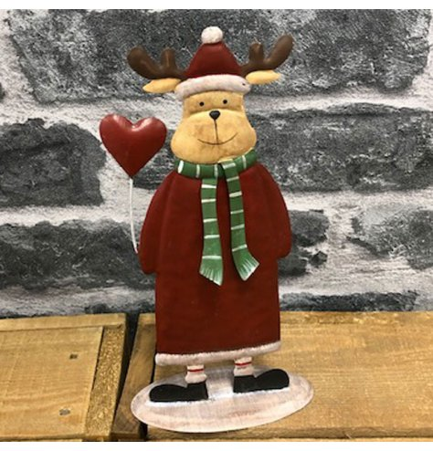 A metal standing reindeer decoration set with festive and traditional tones