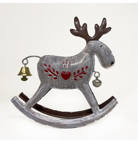 A metal rocking reindeer decoration in a simple white colouring