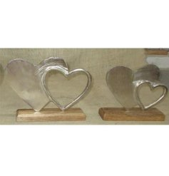 A simple and rustic inspired wooden decoration with an added aluminimum double heart display on it