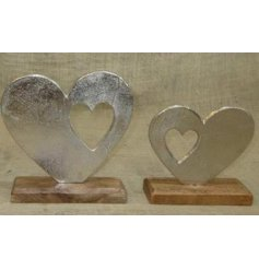 A beautifully simple aluminimum double heart feature set on a natural wooden block base