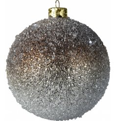 a shatterproof bauble decorated with a glitzy sequin cover and ombre bronze tone