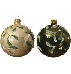 an assortment of gold and green toned baubles with a mistletoe print