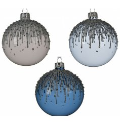 A mix of opaque baubles set with Blue, White and Grey hues and decorated with sparkling glitter droplets
