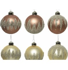 A sleek assortment of camel brown and champagne toned matte baubles, each set with a spiked beaded design