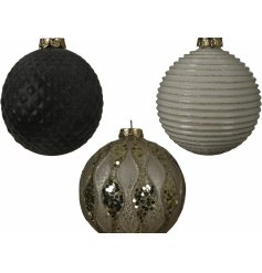 An assortment of luxe inspired glass baubles, each decorated with its own tone and ridged design