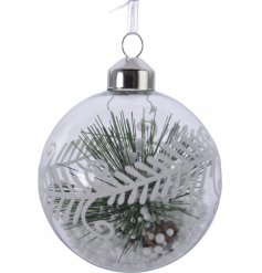 A beautiful set of 3 clear glass baubles filled with pine branch and fake snow
