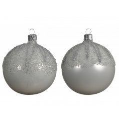 Perfect for adding to any tree display with a Winter Wonderland theme, an assortment of shiny and matte white baubles