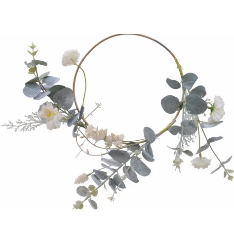 A beautiful, simple white and green wreath with eucalyptus and flowers.