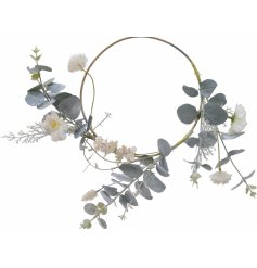 this half wreath is entwined with a beautiful artificial floral bloom and frosted leave design